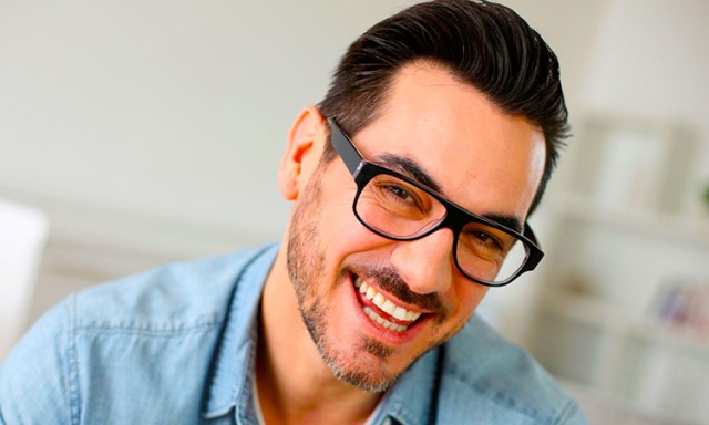 Cheerful handsome trendy guy with glasses